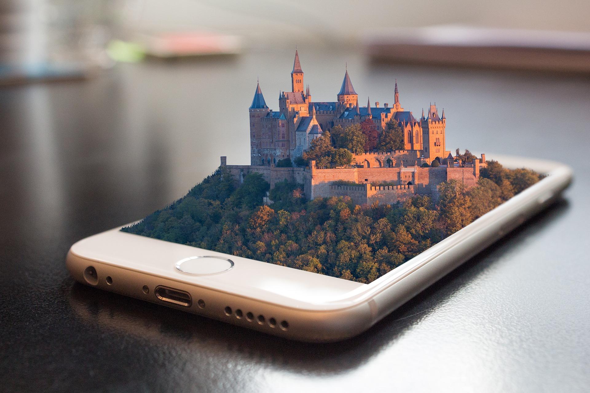 Das Bild zeigt ein Smartphone mit einem 3D-Bild einer Stadt, die sich aus dem Display erhebt.