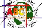Das Bild zeigt die Buchstaben A, B, C vor einer Weltkugel.