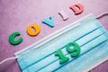 Mundschutz mit Covid 19 Schrift