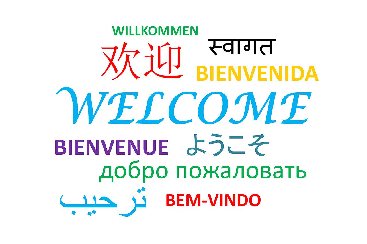 """Das Bild zeigt das Wort """"Willkommen"""" in verschiedenen Sprachen."""