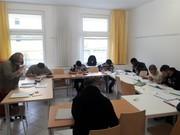 Das Bild zeigt eine Sprachlernklasse.