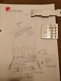 Das Bild zeigt eine Bleistiftskizze des ersten Entwurfes zum OER-Award 2017.